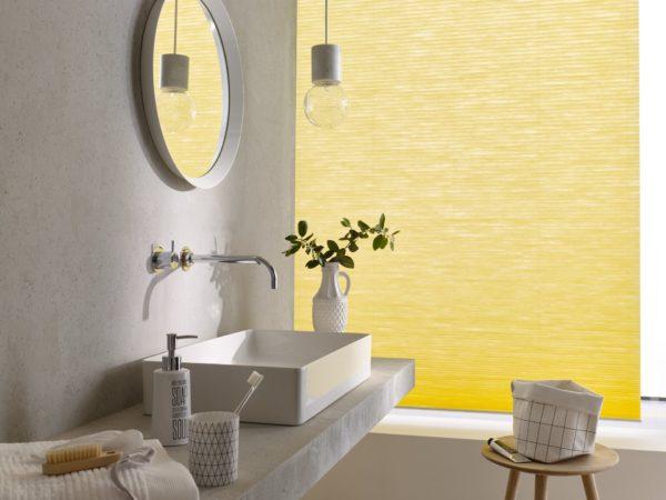 Im Badezimmer sorgen sonnige Farben für ein warmes Licht auch an kühlen Tagen