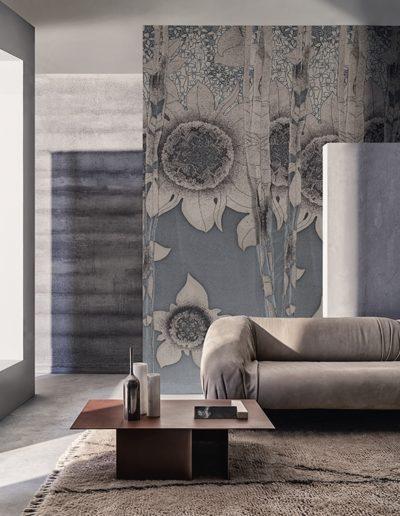 Pastellige Blautöne sind im Wohnzimmer immer ein freundlicher Farbakzent. Die dezente Farbgebung wir mit einem floralen Motiv in schwarz-weiß perfekt abgerundet.